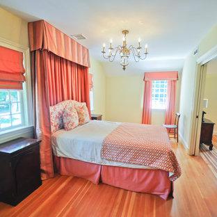 Example of a huge classic master light wood floor and brown floor bedroom design in Bridgeport with yellow walls and no fireplace