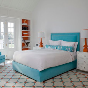 Large trendy white floor bedroom photo in New York with white walls and no fireplace