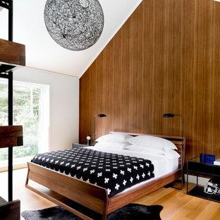 Bedroom - modern guest light wood floor and beige floor bedroom idea in New York with brown walls