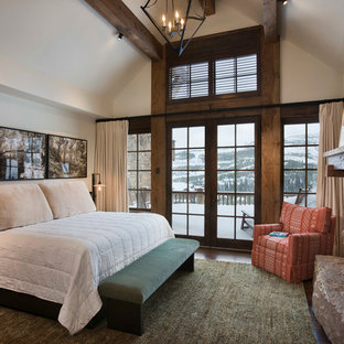 Inspiration for a rustic bedroom remodel in Other with white walls