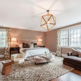 Bedroom - mid-sized contemporary master medium tone wood floor bedroom idea in New York with brown walls