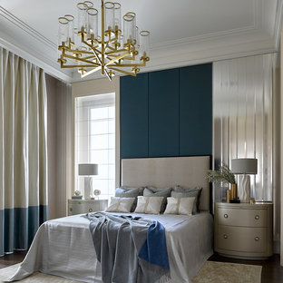 Design ideas for a transitional master bedroom in London with green walls and dark hardwood floors.
