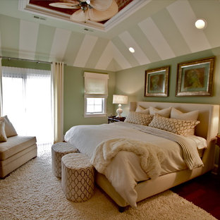 Example of a transitional bedroom design in Chicago with green walls