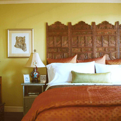 Example of a bedroom design in San Francisco with yellow walls