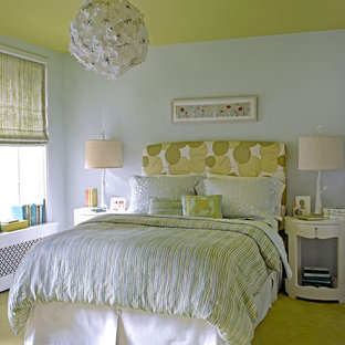 Inspiration for an eclectic carpeted and green floor bedroom remodel in New York with white walls and no fireplace