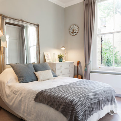 Eclectic carpeted bedroom photo in London with gray walls