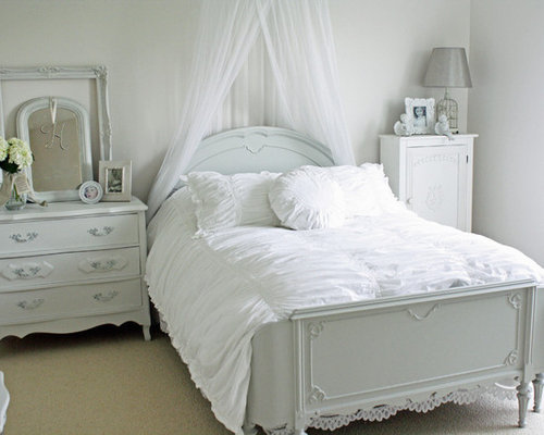 example of a cottage chic bedroom design in chicago with white walls and carpet - High End Bedroom Designs