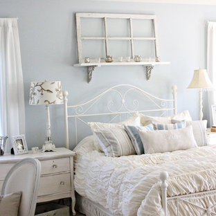 Example of a cottage chic bedroom design in Chicago