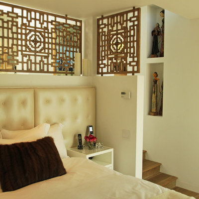 Example of an eclectic bedroom design in Los Angeles with beige walls