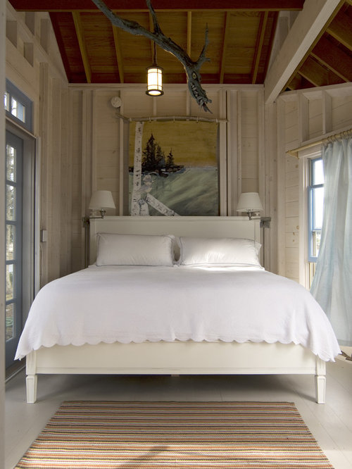 Inspiration For A Shabby Chic Style Painted Wood Floor Bedroom Remodel
