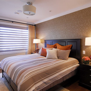 Example of an eclectic bedroom design in Vancouver with orange walls