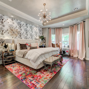 Example of a large eclectic master dark wood floor and brown floor bedroom design in Oklahoma City with gray walls