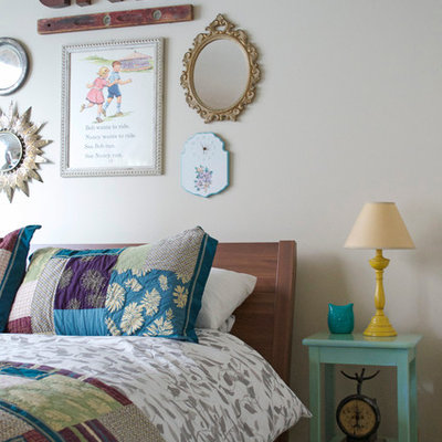 Inspiration for an eclectic bedroom remodel in Dallas with white walls
