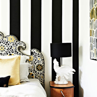 Inspiration for an eclectic master bedroom in Melbourne with no fireplace.