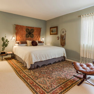 This is an example of a large eclectic master bedroom in Los Angeles with green walls, carpet, no fireplace and beige floor.