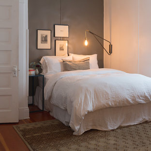 Bedroom - small eclectic master medium tone wood floor and brown floor bedroom idea in Seattle with gray walls and no fireplace