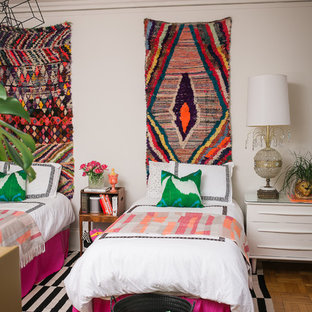 Eclectic guest medium tone wood floor bedroom photo in Chicago with white walls and no fireplace
