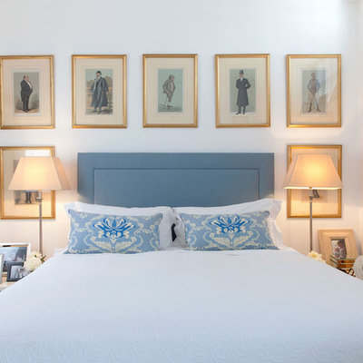 Elegant bedroom photo in London with white walls