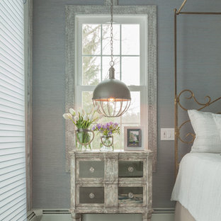 Inspiration for a large shabby-chic style master dark wood floor and black floor bedroom remodel in Other with multicolored walls