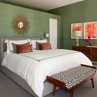 Medium sized retro guest bedroom in Los Angeles with green walls, carpet and no fireplace.