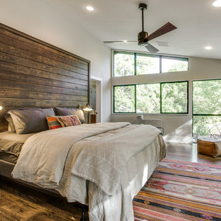 Bon Example Of A Southwest Master Dark Wood Floor Bedroom Design In Dallas With  White Walls