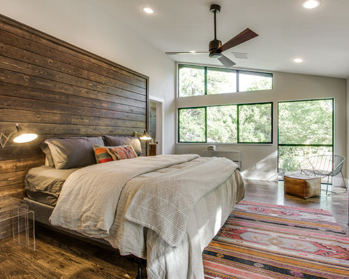 Example Of A Southwest Master Dark Wood Floor Bedroom Design In Dallas With  White Walls