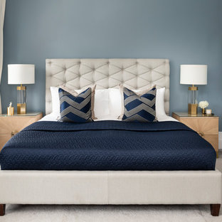 Design ideas for a contemporary master bedroom in London with blue walls, carpet and beige floors.