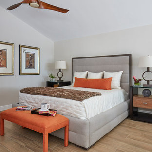 Inspiration for a zen master beige floor bedroom remodel in Miami with gray walls and no fireplace