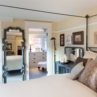 Example of a large cottage chic master carpeted bedroom design in Portland with yellow walls and no fireplace