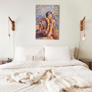 Eclectic medium tone wood floor bedroom photo in San Francisco with gray walls