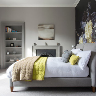 Design ideas for a classic bedroom in Edinburgh with grey walls, carpet, a hanging fireplace, a metal fireplace surround and grey floors.
