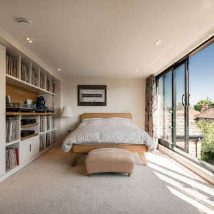 Design ideas for a contemporary bedroom in Cheshire with beige walls, carpet, no fireplace and beige floors.