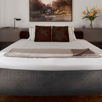 Large trendy master carpeted bedroom photo in San Francisco with white walls and no fireplace