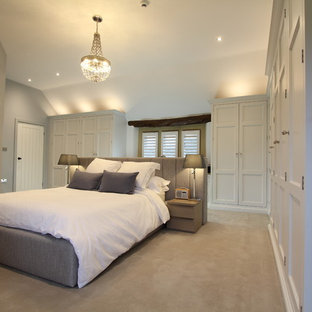 Inspiration for a large traditional master bedroom in Other with grey walls, carpet, no fireplace and grey floors.
