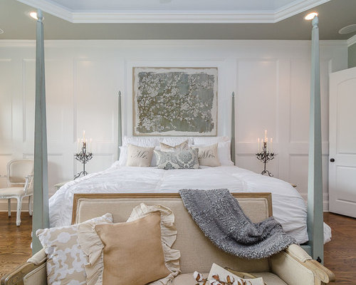 Cottage chic master medium tone wood floor bedroom photo in nashville with white walls