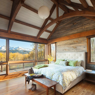 Bedroom - large rustic master light wood floor and brown floor bedroom idea in Boston with brown walls and no fireplace
