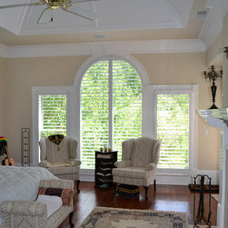 Elite Clear View Shutter Designs - This photo shows a large arch top window in our clear view shutters. This photo was part of a whole house shutter installation of the Jones Residence in North Atlanta.