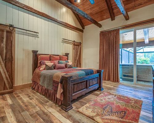 rustic style bedroom furniture rustic. Mountain Style Master Medium Tone Wood Floor Bedroom Photo In Atlanta With White Walls Rustic Furniture