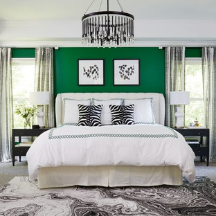 Photo of a transitional master bedroom in DC Metro with green walls, carpet and grey floor.
