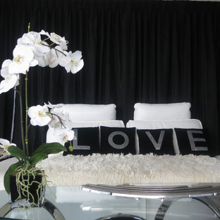 Inspiration for a mid-sized master bedroom remodel in Miami with black walls and no fireplace