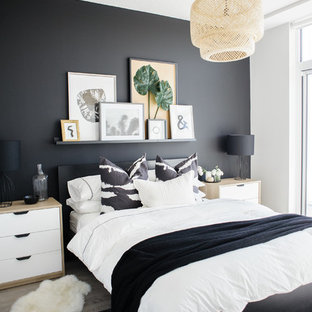 Design ideas for a contemporary bedroom in Toronto with black walls, light hardwood flooring and beige floors.