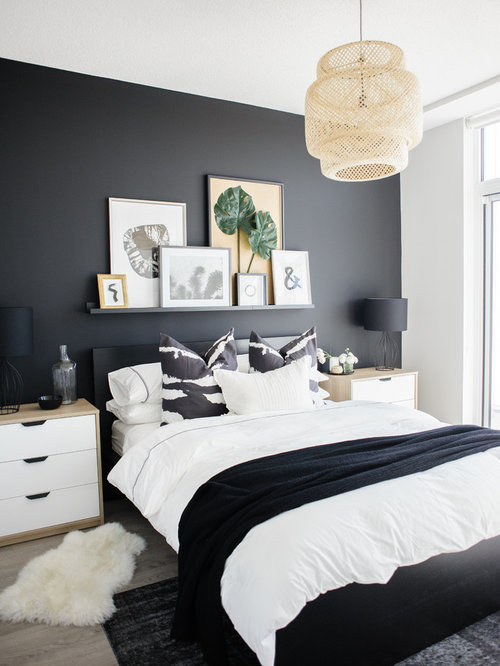 Example of a trendy light wood floor and beige floor bedroom design in  Toronto with black. Top 100 Contemporary Bedroom Ideas   Decoration Pictures   Houzz