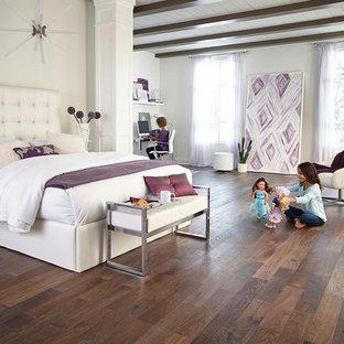 Minimalist master dark wood floor and brown floor bedroom photo in Raleigh with white walls