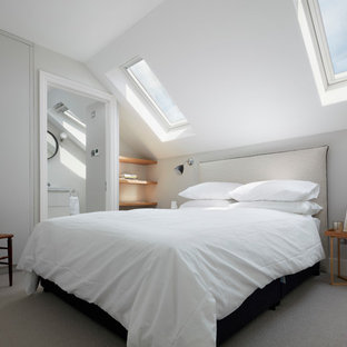 Inspiration for a classic guest bedroom in London with grey walls, carpet and grey floors.