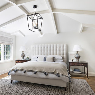 Inspiration for a large transitional master medium tone wood floor and brown floor bedroom remodel in Detroit with white walls