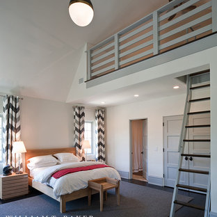 Photo of a transitional loft-style bedroom in Atlanta with white walls, medium hardwood floors and brown floor.