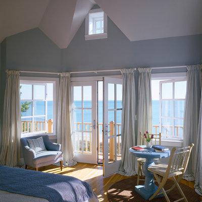 Bedroom - traditional medium tone wood floor bedroom idea in Boston with blue walls
