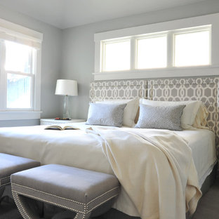 Example of a classic carpeted bedroom design in Vancouver with gray walls and no fireplace
