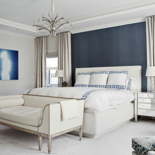 Example of a transitional master carpeted bedroom design in New York with blue walls