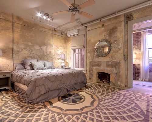 Example Of An Urban Concrete Floor And Gray Floor Bedroom Design In New  Orleans With Beige